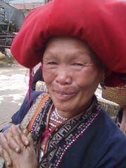 Massive red tasseled turbans denote the Red Dzhou ethnic group.