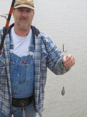 Jon Belcher displays the rig he uses while snagging for spoonbill on the Osage River. He uses treble hooks with a 6 ounce sinker to catch the monster fish.
