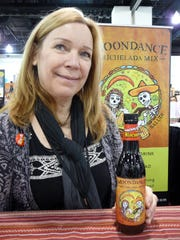 Laurie Pedersen of West Bend holds her Moondance Michelada,