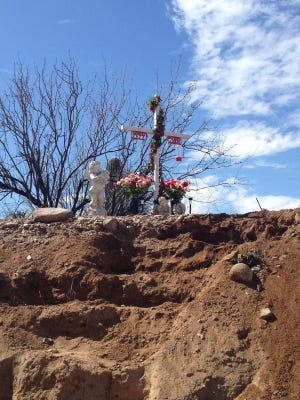 The roadside memorial site for Carmen Rios, who was killed by a drunken driver in 2000 on her way home from work.