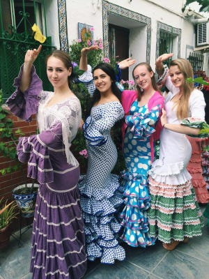 Emily Durfee (left to right), Cassidy DeStefano, Katie Downing and Shannon Boyle all wore traditional attire for a flamenco lesson, a requirement for their culture class.