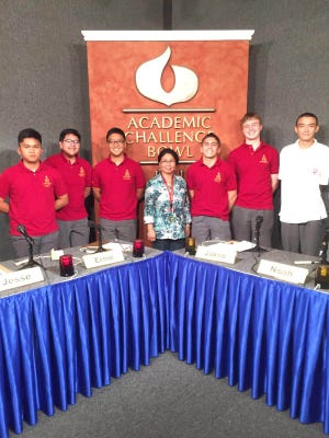 The Academic Challenge Bowl team from Father Duenas Memorial School poses after a local match. From left: Jakob Rosario, Noah Rapadas, Russell Pasetes, coach Jovita Manzanilla, captain Leonard Calvo, Jack Martinez and Ethan Story.