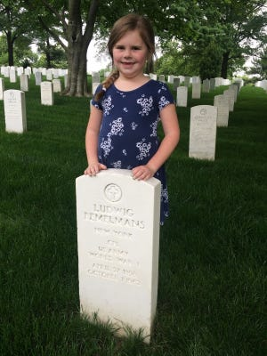 Natalie DiStefano, of Whitehouse Station, at the grave site of author Ludwig Bemelmans in Arlington Cemetery. The author's grandson John Bemelmans Marciano, a well-known author in his own right, spent a day in June with Natalie and her schoolmates at Whitehouse School as an Author-in-Residence.