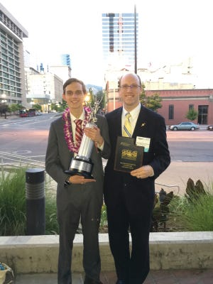 Graduating senior Bradley Wascher and St. James School coach Ian Turnipseed at the National Speech and Debate Tournament in Salt Lake City.
