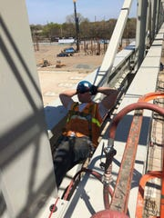 Ironworker Walter F. Lenkowski is seen working on another job for Ironworkers Local 399. He was an ironworker for five years, starting as an apprentice, then graduating to journeyman.