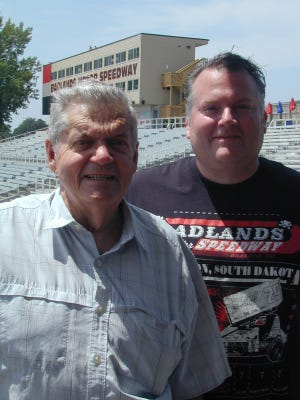 Tom Savage (left) and Tom A. Savage are father and son familiar to those in the auto racing world.