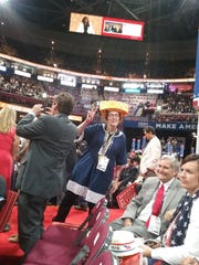 Barbara Finger, Wisconsin 8th District cheesehead delegate, gestures on the floor of the Republican National Convention in Cleveland.
