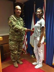 Montgomery Army recruiting officer welcomes a new soldier.