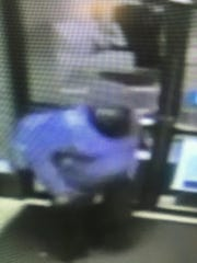 Surveillance camera picture of one of the two suspects in a burglary that took place at the Piercing Pagoda kiosk inside the Lebanon Valley Mall early Thursday morning. A substantial amount of jewelry was stolen, according to police, but the total value of the merchandise has not been disclosed.