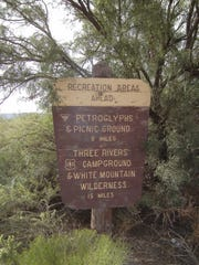 A sign points the way to recreation areas.
