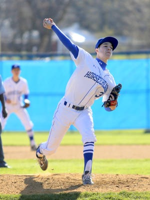 Mike Limoncelli of Horseheads delivers a pitch during a game in April.