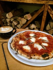 Anodyne Coffee Roasting Co.'s Bay View cafe makes Neapolitan-style pizzas in its Italian wood-burning oven, such as this pizza with anchovies.