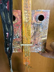 Cigar box guitar by artist Dawn Patel that is part of the auction at the 25th anniversary celebration for Door Community Auditorium.