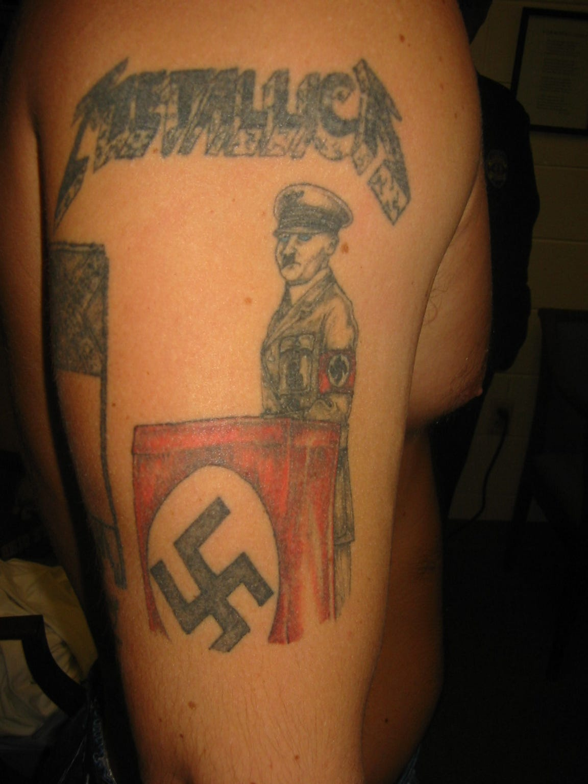 Adolph Hitler is displayed on an inmate's arm.
