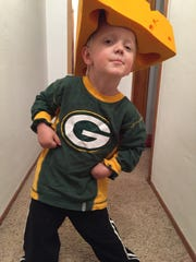 Four-year-old Packer Jay Linville of Durango, Colo., gets his game face on. His parents named him after the Green Bay Packers.