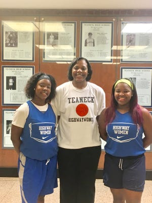 Destiny Dow (left) and Cedeja James (right) posing with new Teaneck coach Dr. Trinette Carruthers.