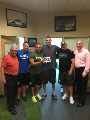 Former FGCU ace Chris Sale was at FGCU Tuesday as news of his trade from the White Sox to the Red Sox broke. With him are, from left, FGCU's Butch Perchan, Wes Sargent, Dave Tollett, Rusty McKee and Ken Kavanagh.