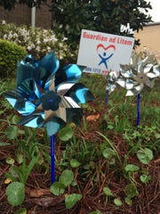 The Guardian ad Litem program's pinwheel garden shines in honor of Child Abuse Prevention month. The Guardian ad Litem is planning a training session for volunteers.