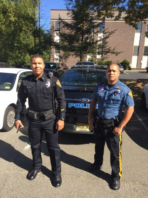 Haledon Police Department's  new uniform, on Officer John Bonilla on left, with the outgoing uniform worn by Special Police Officer Steven Guzman on right.