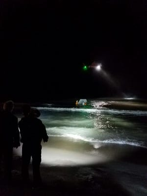 Burtchville Township firefighters and a U.S. Coast Guard helicopter respond to an errant ice shanty.