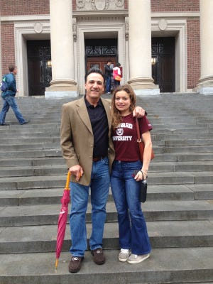 Dominique Luongo (right) and Phil Cuzzi, here in 2014. Luongo is a senior at Harvard.