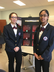 Newark Charter's Shu-Jin Kust, left, and Tanvi Venkatesh stand in front of their display on Marfan Syndrome.