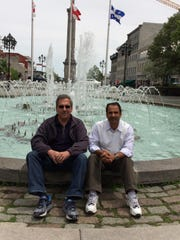 Abi Chamlagai and Bob Battaline met through the Vermont Refugee Resettlement Program. They are now fast friends. They're seen here at the fountain at Place Vauquelin in Montreal.