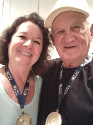 Bud and Kathy Stone won gold medals at the Florida Senior Games for winning their age group in the game of cornhole.