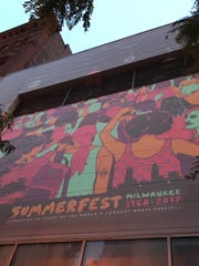 The Summerfest poster was projected on a building