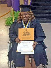After suffering a stroke, Coretta Greathouse was determined to make it to graduate school commencement ceremonies at Alcorn State  University in Lorman. Here, she shows off her master's degree in applied science and technology management.