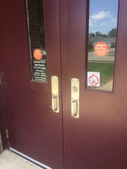 Signs saying Òno smokingÓ and telling Òparents and visitorsÓ to Greenfield HS to sign in at the front desk are still affixed to the doors of what is now Lincoln Park Apts.