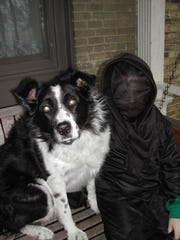Throughout the years, farm dogs pass in and out of our lives. And there are some whose memories linger on long after they're gone, like Bandit, joining my young son wearing his Halloween costume.
