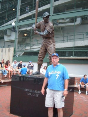 Jay Hultberg with a statue of Willie Banks
