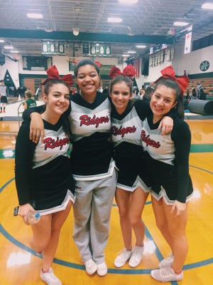 Glen Ridge cheerleaders (from left) Julia VanSickle, team captains Gia Goodwin and Madison Lance and Lily Nicles.