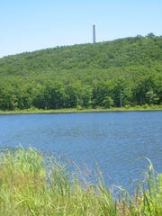 A view of Steeny Kill Lake from the Steeny Kill Trail, with the High Point Monument in the background.