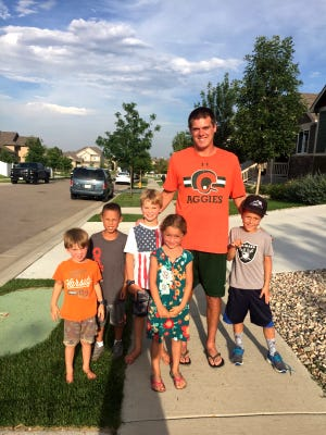 CSU quarterback Nick Stevens poses for a picture with some neighborhood kids he joined for a pickup football game Sunday near his home in northeast Fort Collins.