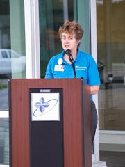 Jane Curran-Meuli, HFM chief operating officer/executive vice president, at the ribbon-cutting for the new Lakefront Campus in Two Rivers on Saturday.