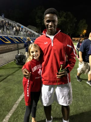 Belleville's Ifeanyi Anaemejeh, here with coach Gary Polewka's daughter Jennie, earned first-team All-SEC honors.