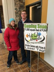 Mike and Nicole Schreiner stand outside by their sign Hub City Adventure on Wednesday, Nov. 22.