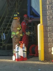 Emergency personnel respond to a confined space rescue