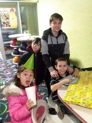 Zach Foller (top), of Dover, helps his friend celebrate his ninth birthday. After he turns 14 on Jan. 28, Zach plans to get a work permit so he can get a job as a party planner at a bowling alley.
