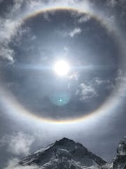 """This phenomenon is called a """"sun dog,"""" and is formed by ice crystals reflected in sunlight."""