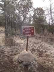 This sign is marks the site of the murder of John Henry