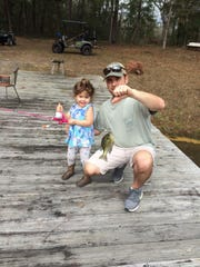 Little Georgia Hader with her first ever fish. She was fishing with her dad, Bret Hader, in a farm pond.
