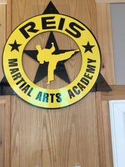 Reis Martial Arts Academy logo in the waiting room.