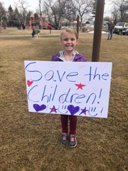 A rally-goer shows off her sign at the March For Our