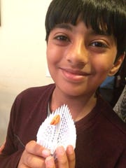 Vishal Pamulapati with an origami piece.
