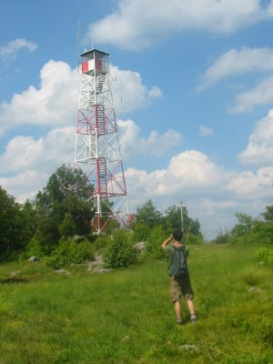 A hiker approaches the Bearfort Fire Tower along the Fire Tower Ridge Trail in the Pequannock Watershed section of West Milford in this June 30, 2008 photo.