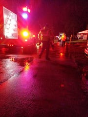 Emergency workers early Saturday morning, April 14,