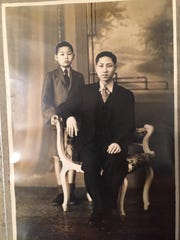 Davis is with his only sibling, little brother Gee. The photo was taken in China.